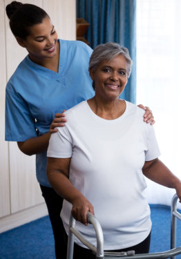 caregiver holding the shoulder of a happy patient