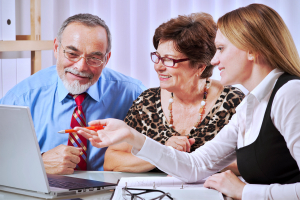 senior couple meeting with insurance agent or advisor