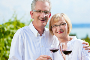 happy mature couple  drinking wine