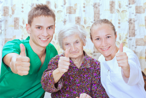 elderly woman with the sweet young nurses