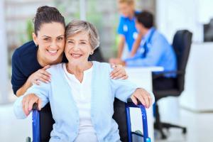caring adult daughter accompanying senior mother